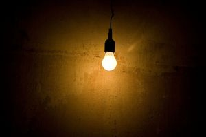 solitary bulb: lonely light on the wall