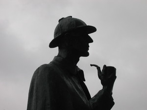 The Great Detective: Sherlock Holmes statue at Baker Street Station in rainy London, UK