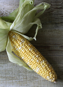 Maize: A maize on a wooden texture background
