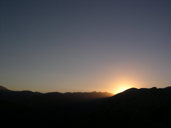 peeking through: sunset over mountains spain