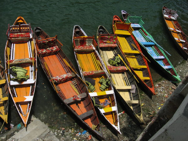 Rainbow Boats: Colourful rowing boats parked at Lake Sat Taal in Uttarakhand, India.