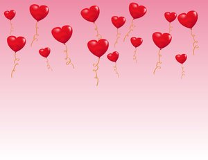 Valentine Balloons: Red valentine balloons over a pink gradient background.  Lots of copyspace.