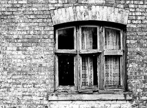 Haunted House: High contrast b&w image of a derelict and rather spooky farmhouse.