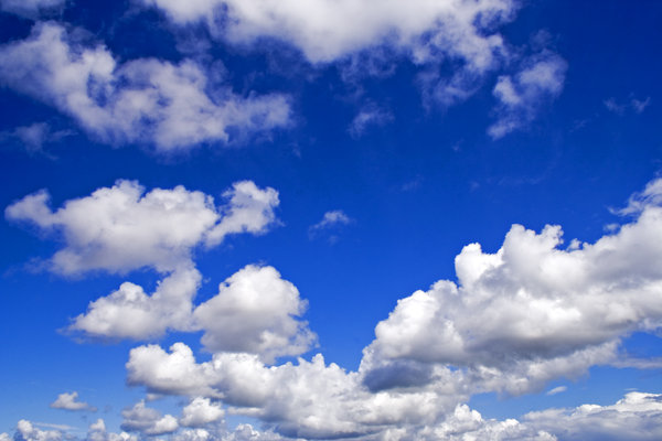 Dramatic Skies: Fluffy white clouds on a bright blue sky.