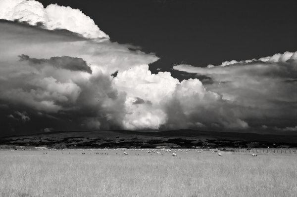 Faux IR Landscape: Storm brewing over the Trough of Bowland, UK.  If you look closely there are a group of parachutists descending left of centre.  Use of faux IR technique for dramatic effect.
