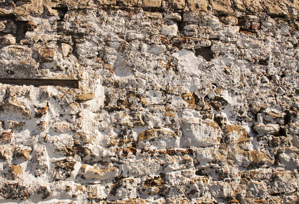 Whitewashed Stone Wall: An ancient stone wall that has been whitewashed.
