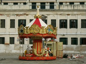 End of a romance-: Merry-go-round still standing on a big empty square getting removed as the last or maybe only attraction.