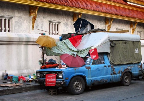 Patterns of decay-: Homeless mobile home? on the street alongside a buddhist temple (Thailand, Bangkok)