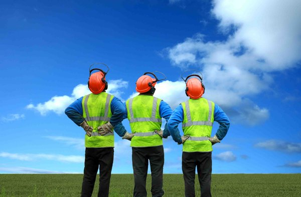 Blue Sky Thinking: Three construction workers and a blue sky