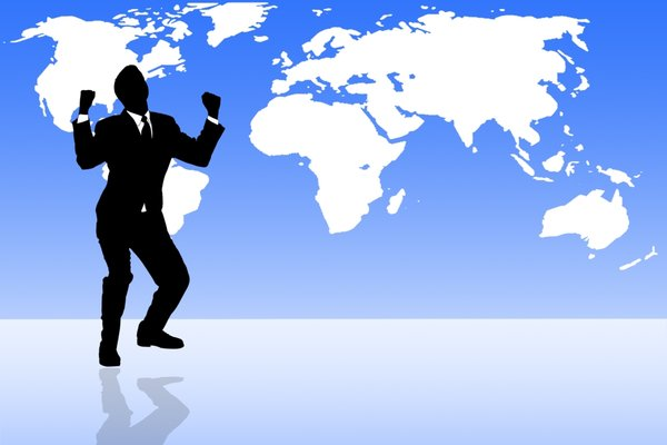 Business Happy: Male expressing happiness against a world map