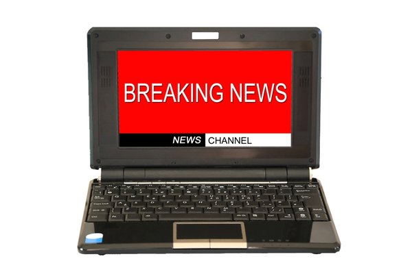 Breaking News: Laptop computer with breaking news screen