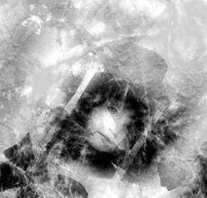 Grunge - Cobwebs on old Photo: Grungy black and white photo of a child's face covered with cobwebs.