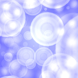 Bokeh on Blue 2: Bokeh, or blurred background lights. Suitable for a background, Christmas greetings, holiday greetings, texture, or fill.
