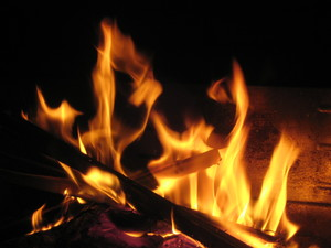 Fire and flames: Burning wood. Flames of an outdoor fire.