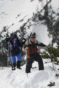 Winter trekking in RaxAlps: Male and female climbing in winter in Rax-Alps.