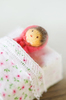 Get well soon: Tiny doll house doll in bed