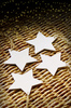Basic Christmas: Wooden Christmas decoration stars on wicker background