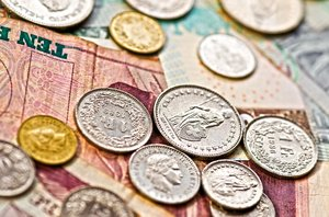 Money: paper money and coins close up