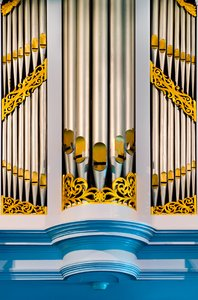 Church organ: Brightly colored church organ pipes