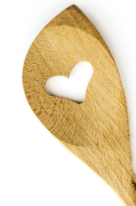 Love cooking: wooden cooking ladle with heart cut out