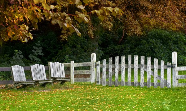 Garden in fall: wooden chairs in a fall garden